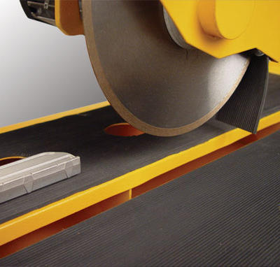The main cutting table is covered with a rubber mat that steadies the material being cut for greater accuracy.