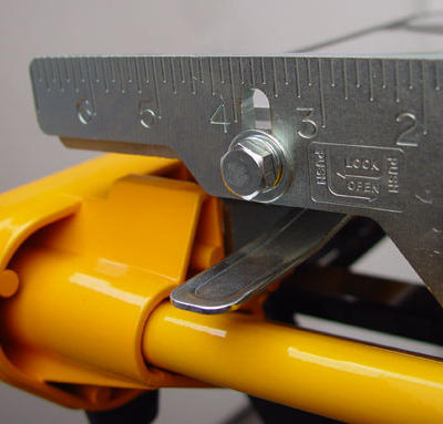 The cutting table is equipped with a spring lock to secure the cutting table in one of two positions. When locked forward, the saw is ready to be transported in between job sites. When locked midway, the table is appropriately positioned for plunge cuts.