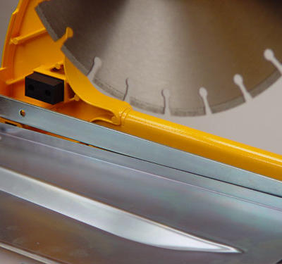 An aluminum plate located beneath the cutting head ensures that the dust generated from the cutting action is directed to the rear of the saw and away from the operator.