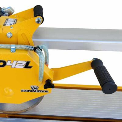 Dual handle system gives user a choice of pulling or plunging the cutting head when cutting a work piece.