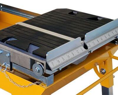 The cutting table features an injection mold rubber mat that provides a firm durable work surface.